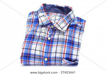 a folded plaid patterned shirt on a white background