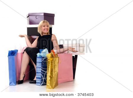 Blond Girl Surrounded By Her Shopping