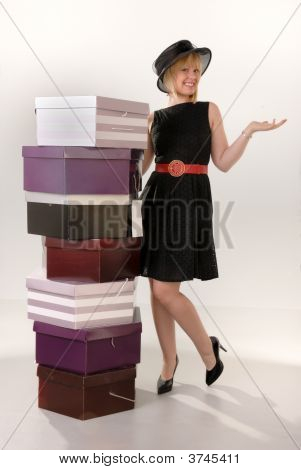 Attractive Blond Girl With Hat Boxes