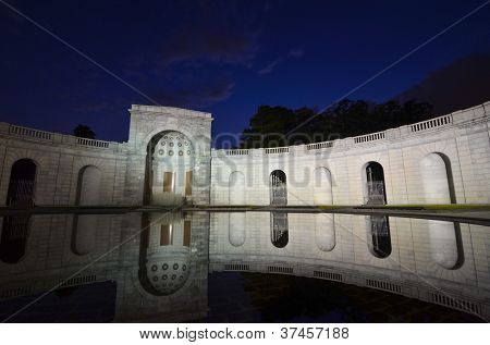 Arlington National Cemetery entrance at night with mirror reflection on the pool, near to Washington DC