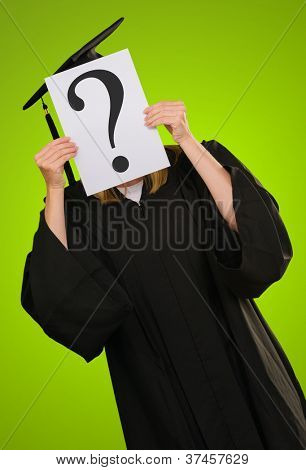 Graduate Woman Holding Paper With Question Mark Symbol On Green Background
