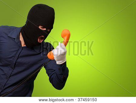 Burglar Man Holding Telephone On Green Background