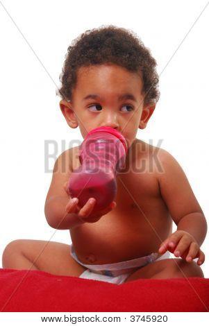 Multi-Racial Baby Drinking