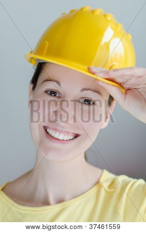 Portrait of attractive smiling architect girl with hard hat