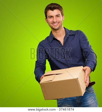 A Young Man Holding Cardboard Box On Green Background
