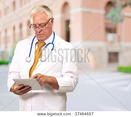 Portrait Of A Male Doctor Holding A Tab, Outdoor