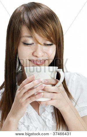 Asian female holding a cup over white background
