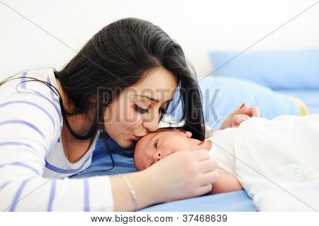 Happy mother with her baby