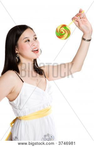 Beautiful Asian Woman And Lollipop