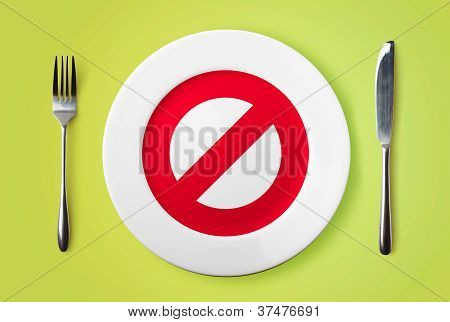 Empty Plate With Restricted Red Sign On It  - Dieting Concept Image