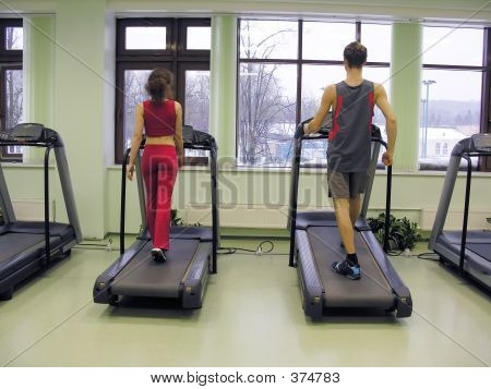 Behind Girl And Boy In Health Club