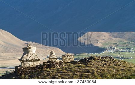 Buddhist Stupas In The Zanskar  Valley On The Background Of The Mountains And Village