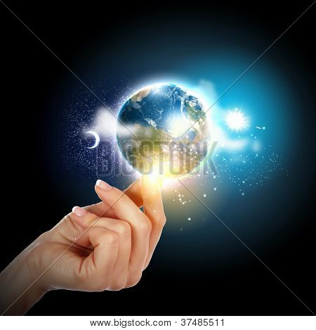 Human hand holding our planet earth glowing.Elements of this image furnished by NASA.