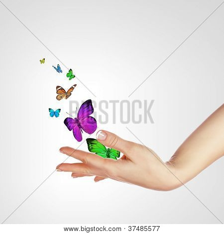 Human hands releasing colourful butterflies illustration on white background