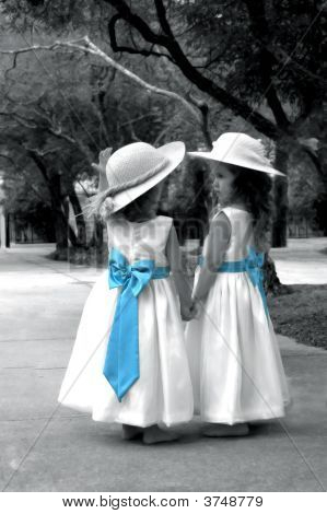 Adorable Girls With Blue Bows