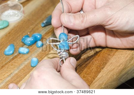 woman hands creating a fashion jewelery