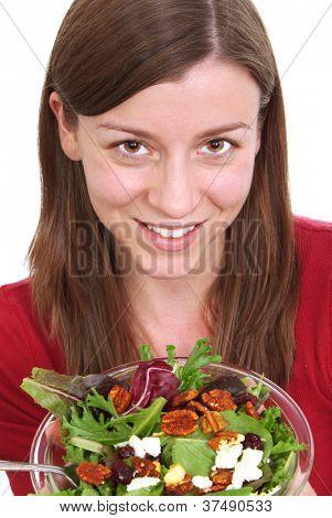 Pretty girl eating a fruit salad