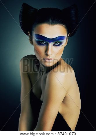 Lovely Young Girl With Dramatic Make Up On Her Face Pose