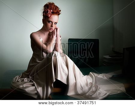 Red Head Freckled Lady In Ivory Fashion Dress On Office Desk