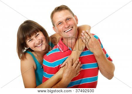 Happy caucasian family having fun and smiling over white. Wife hugs her husband, isolated