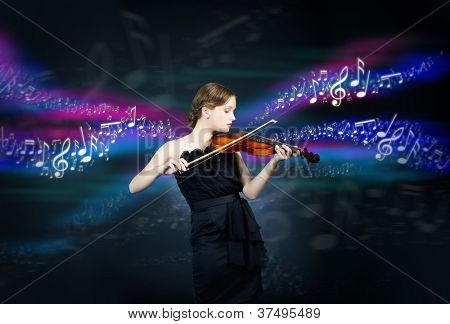 Portrait of a young female playing the violin over creative background