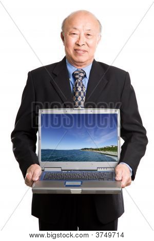 Senior Asian Businessman And Laptop