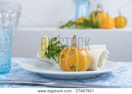 Thanksgiving table setting with decorative pumpkins