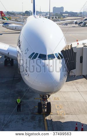 JOHANNESBURG - APRIL 18:Airbus A380 disembarking passengers after intercontinental flights on April 18, 2012 in Johannesburg, South Africa. Johannesburg Tambo airport is the busiest airport in Africa