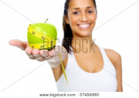 Dieting woman with measuring tape and apple showing healthy eating and weightloss concept isolated on white