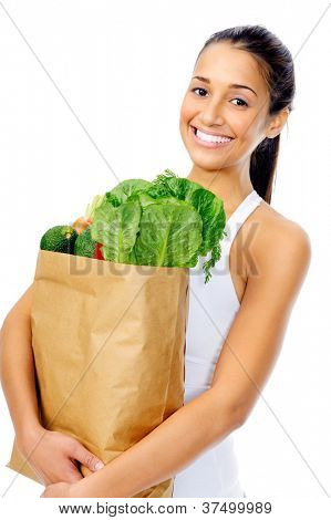 Healthy positive happy woman with paper shopping bag full of organic fruit and vegetables