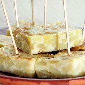 closeup of a plate with a typical spanish tortilla de patatas served as tapas