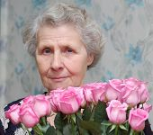 Granny Behind Bouquet Of Pink Rose