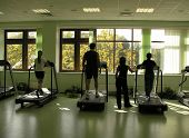 picture of sweatshop  - people with teacher in health club and autumn in window - JPG
