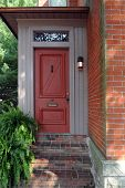 pic of front door  - An inviting front door of an old urban brick home - JPG