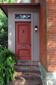 foto of front door  - An inviting front door of an old urban brick home - JPG