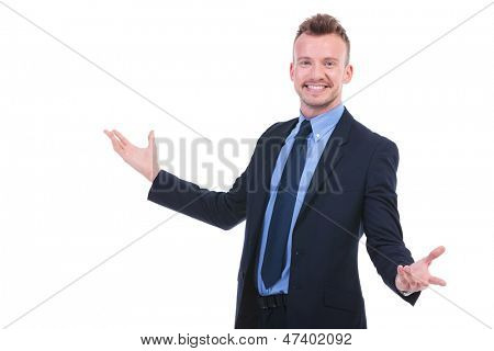 young business man welcoming everybody with a big smile on his face. on white background