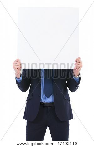young business man holding a blank pannel in front of his face. on white background