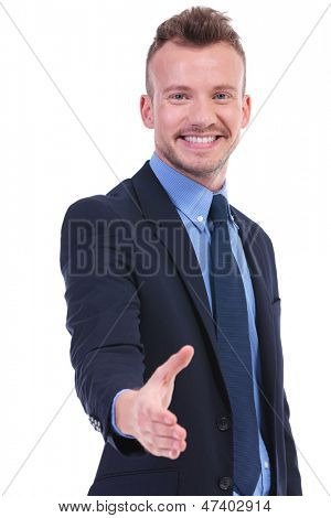 young business man offering a handshake with a smile on his face. on white background