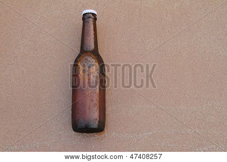 Beer Bottle On The Beach