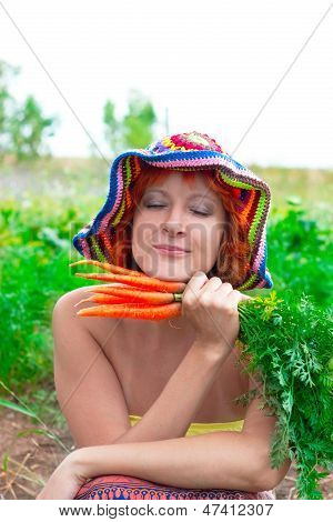 Dreamy Woman With Bunch Of Carrots
