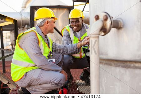 two oil chemical industry technicians working in plant
