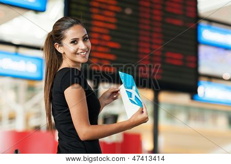 cute young businesswoman travelling by air