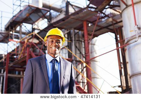 happy african american chemical industry manager in plant