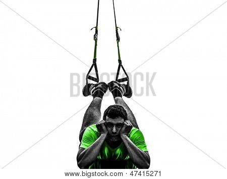 one caucasian man exercising   suspension training  trx tired pouting    on white background