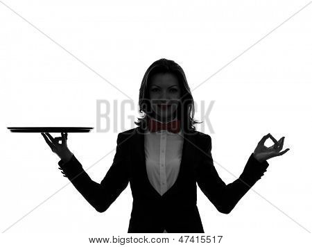 one caucasian woman waiter butler holding empty tray zen gesturing in silhouette  on white background