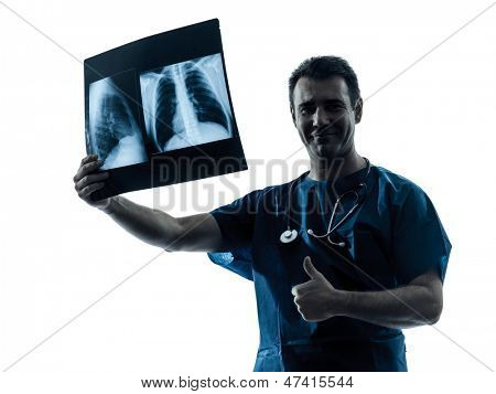one caucasian man doctor surgeon radiologist medical thumb up examining lung torso  x-ray image silhouette isolated on white background