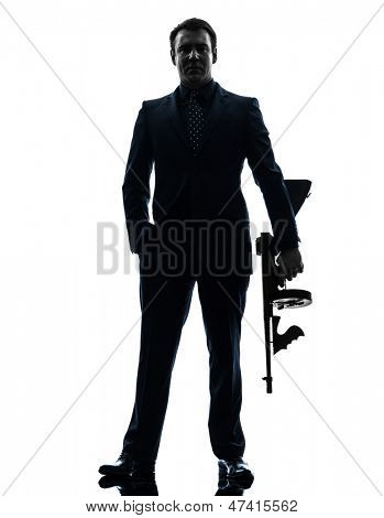 one caucasian man holding thompson machine gun  in silhouette on white background