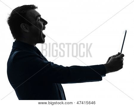 one caucasian business man holding digital tablet  laughing  in silhouette on white background