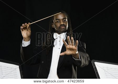 Male conductor holding baton