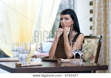 Woman In Restaurent In Anticipation Of